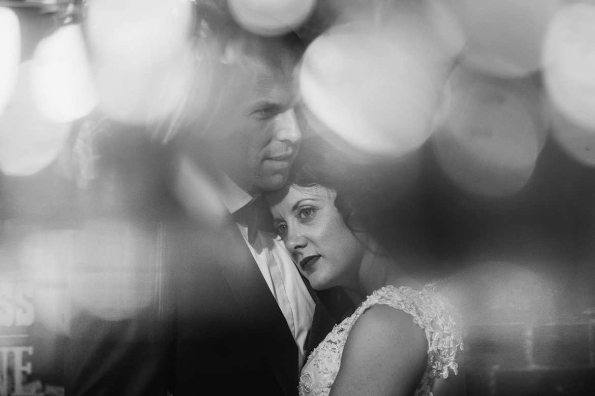 A black and white portrait of the bride and groom