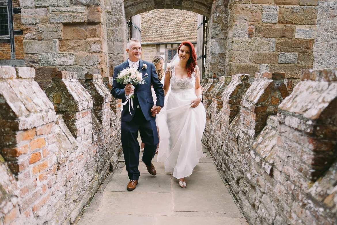 the bride crosses the moat with her father at Birtsmorton Court