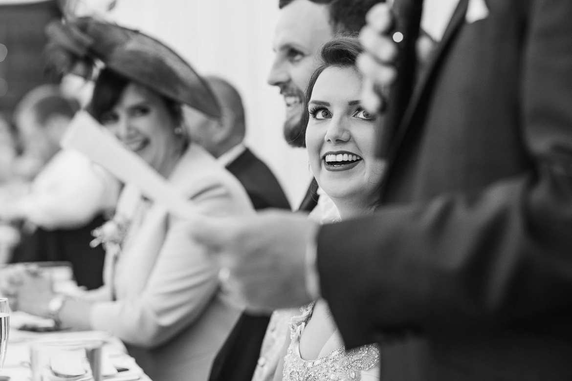 The bride laughing at her dad's speech