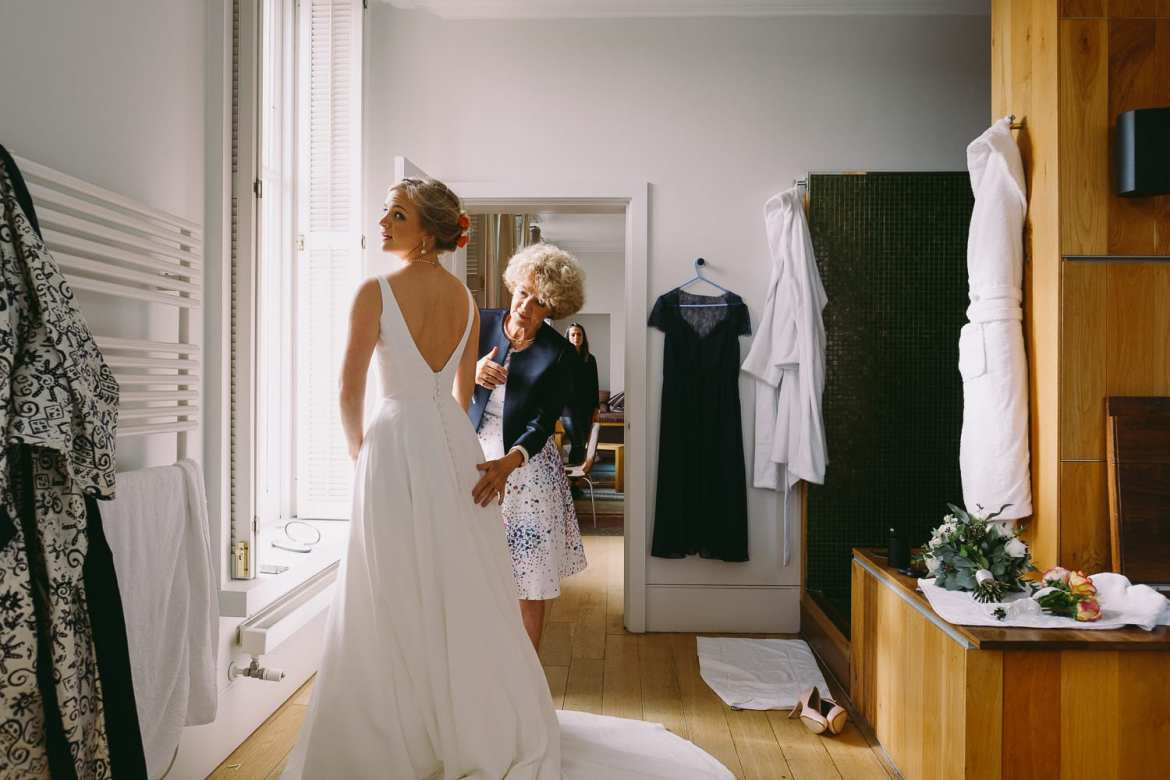 Mum helps with the finishing touches during bridal prep