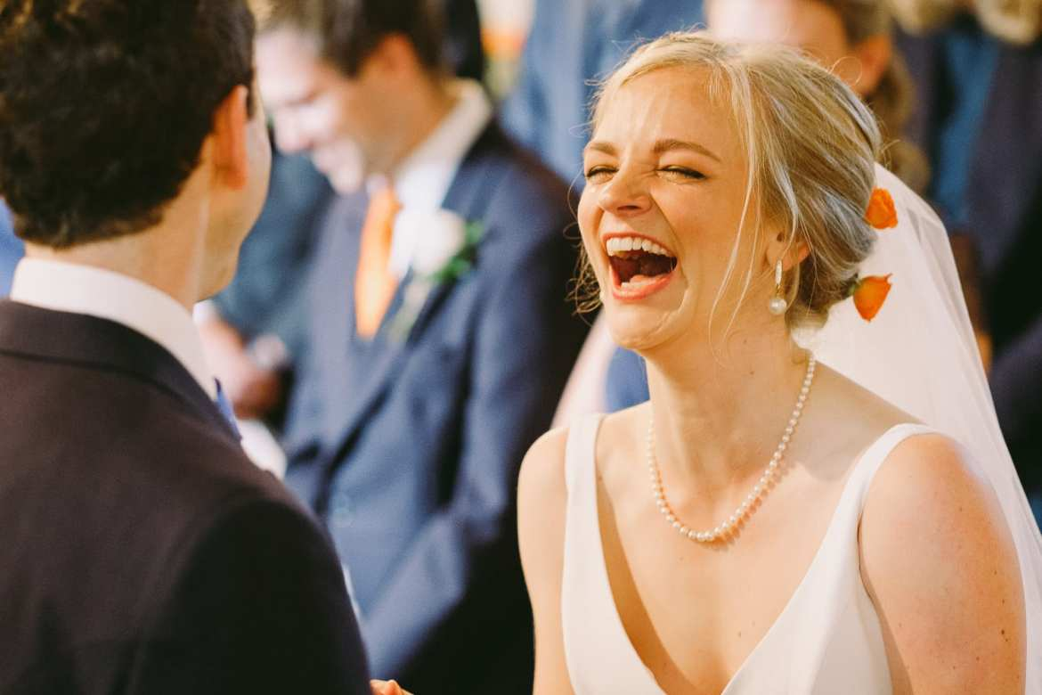 Bride and groom having a laugh during the ceremony