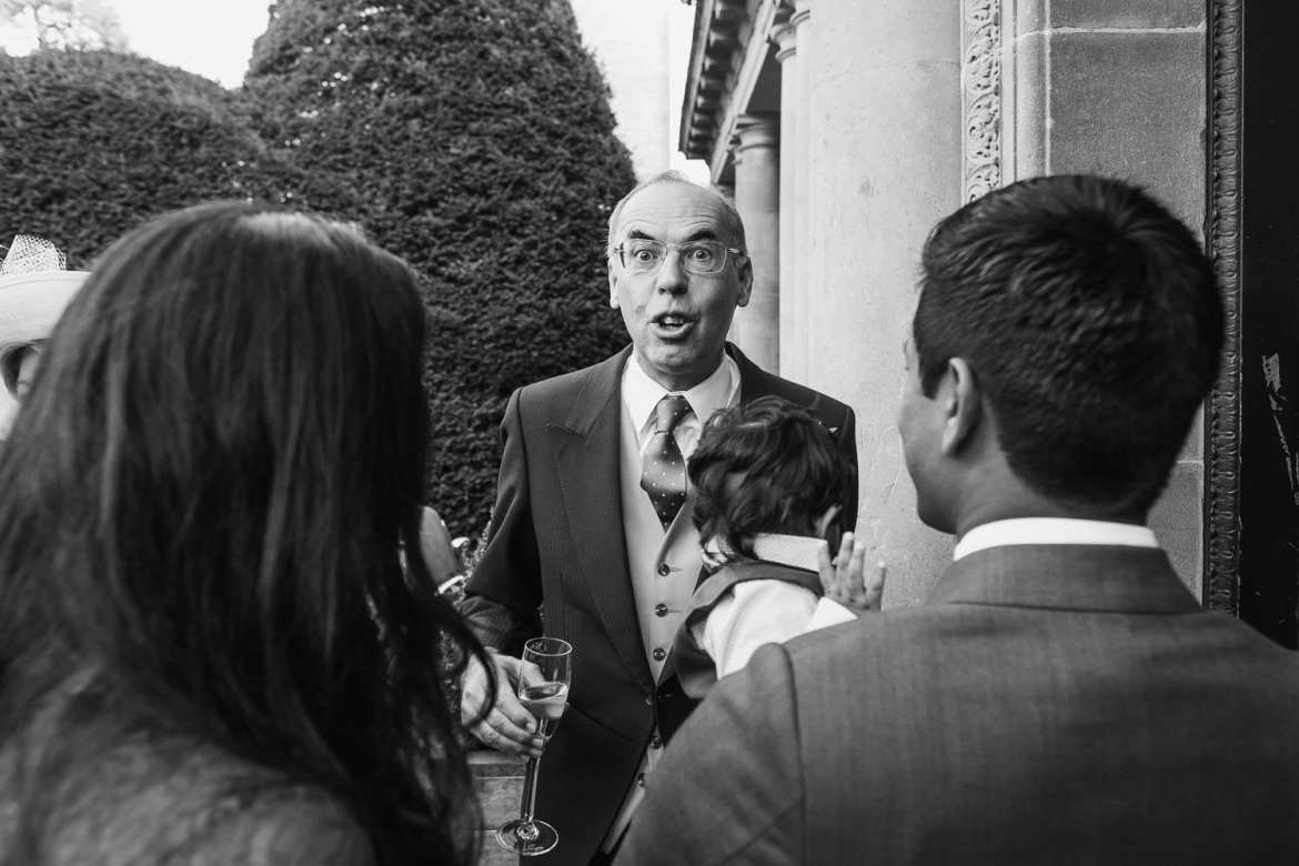 Grooms father greeting guests in the receiving line