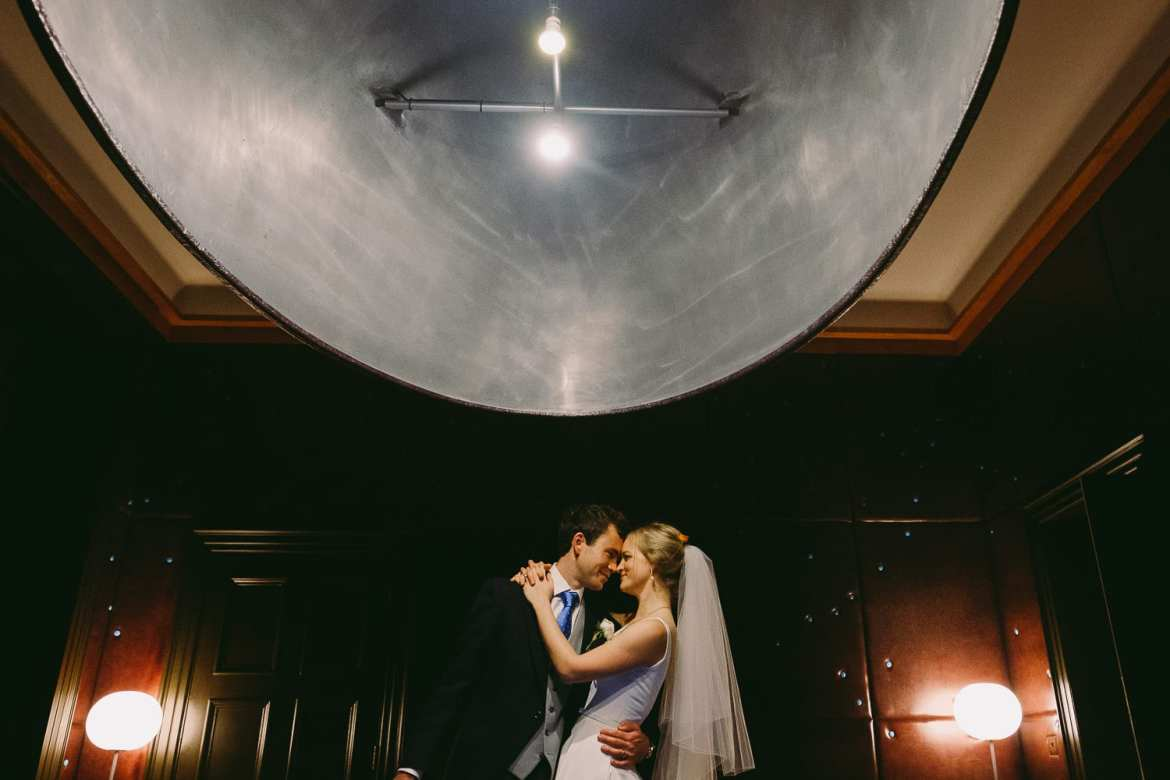 Portrait of bride and groom in snooker room at Cowley Manor