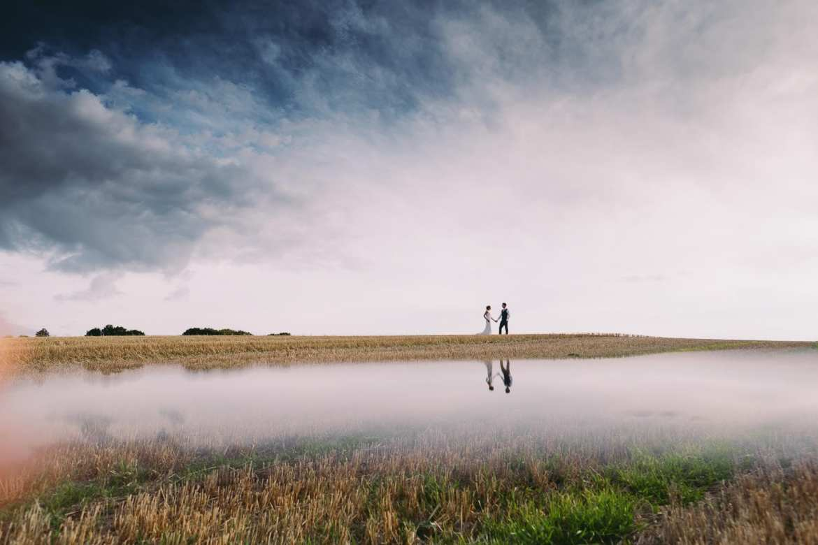 A portrait of the bride and groom in the countryside at Wellington Barn