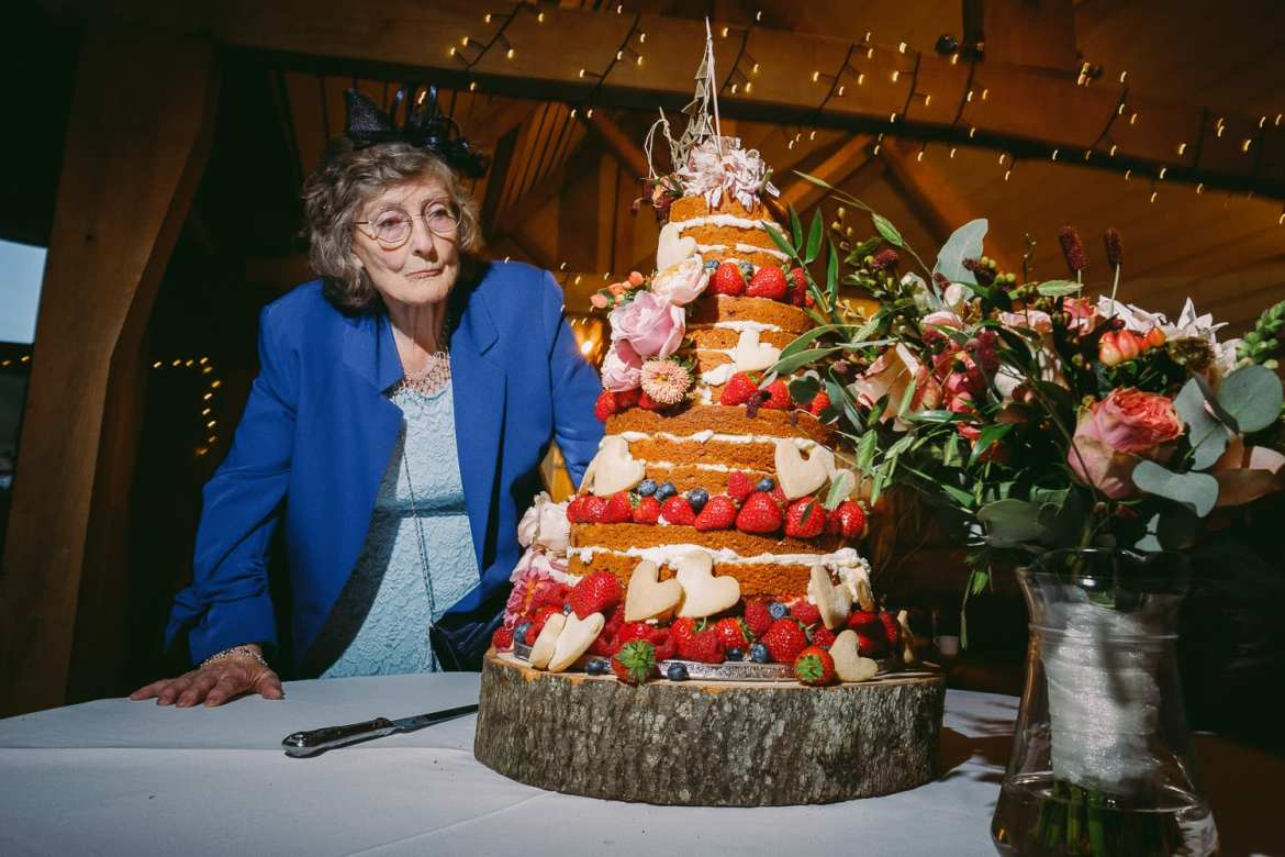 A guest looks at the cake