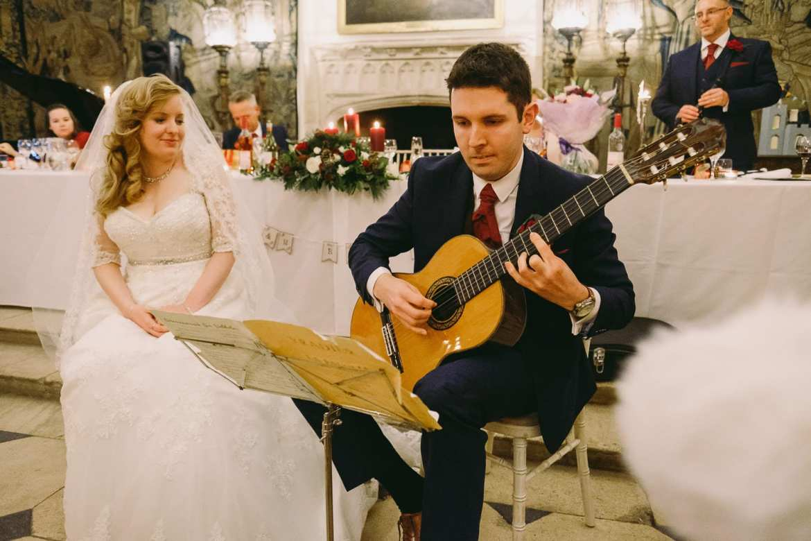 The groom serenades the bride with his guitar