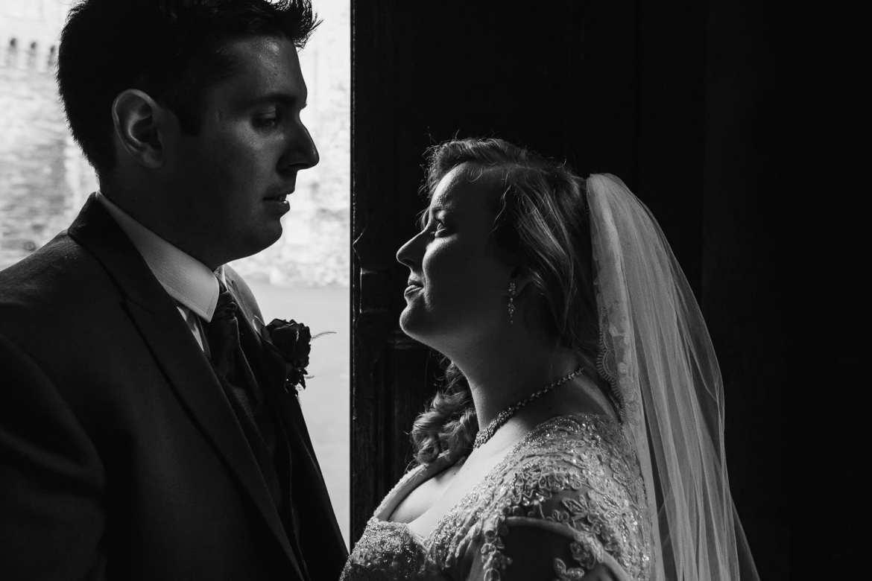 THe bride and groom in the doorway
