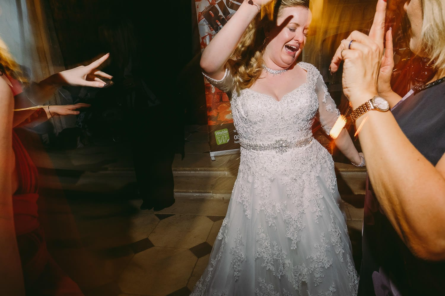The bride dances with guests