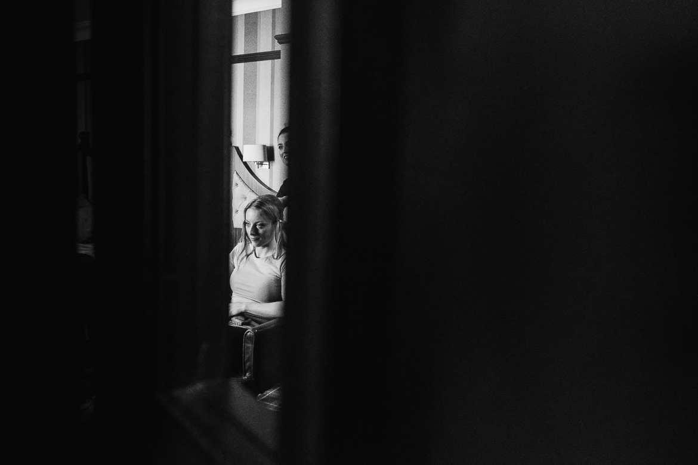 The bride viewed through a door frame