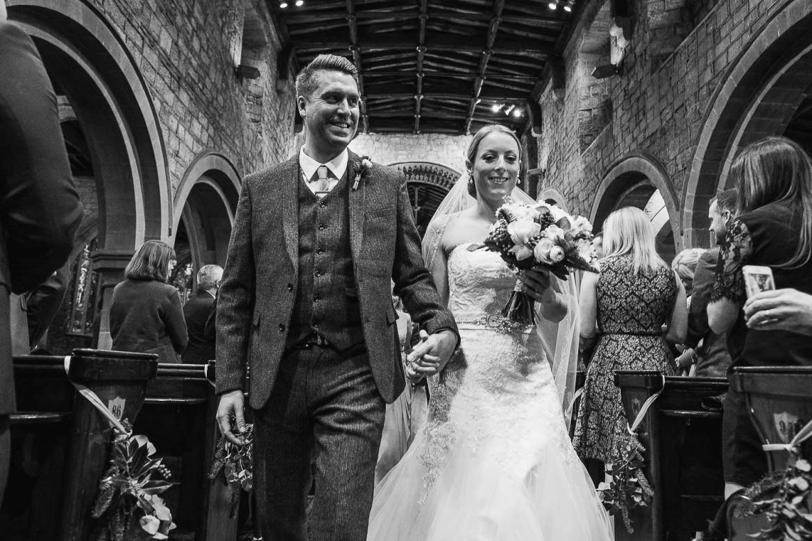 The newlyweds leave the church