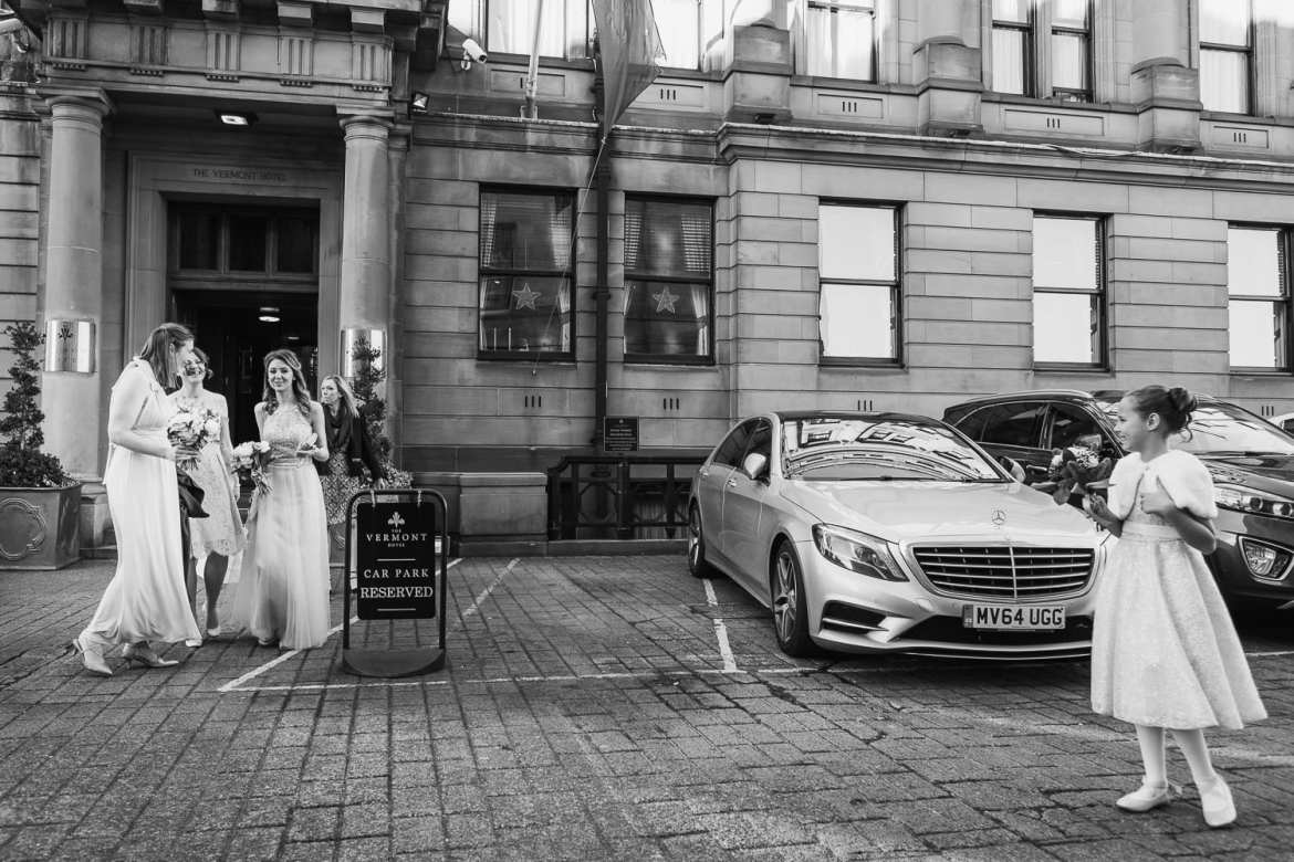 The bridesmaids leave the hotel for the wedding