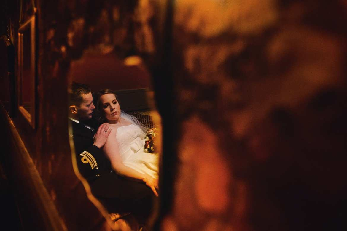 The newlyweds are reflected in a mirror
