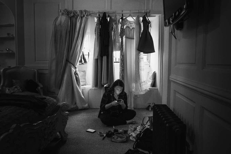 A bridesmaid checks her phone