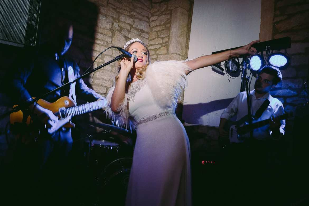 The bride on the microphone in the party barn
