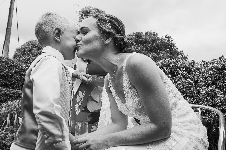 The bride kisses the page boy