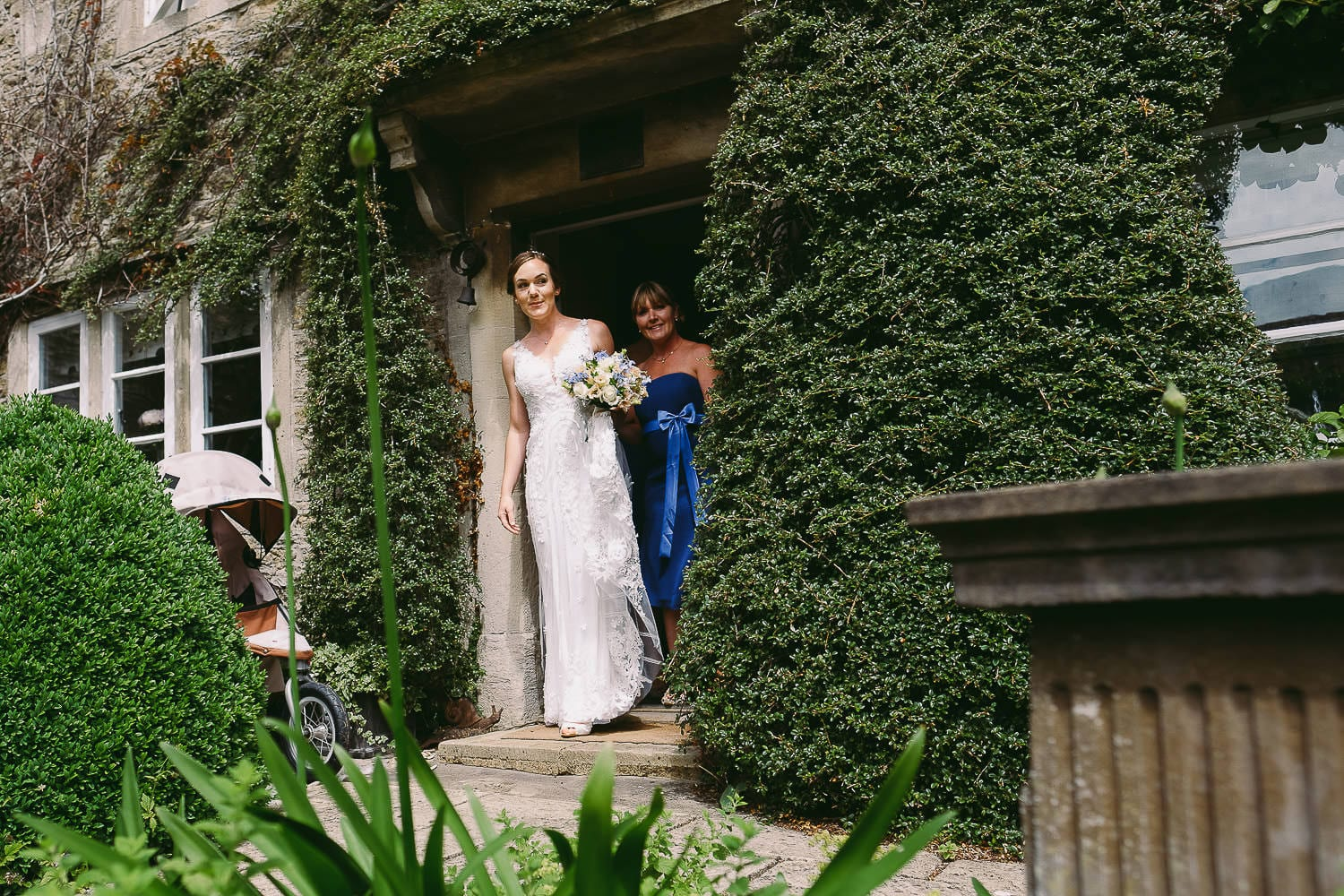 The bride peeks out from the front door