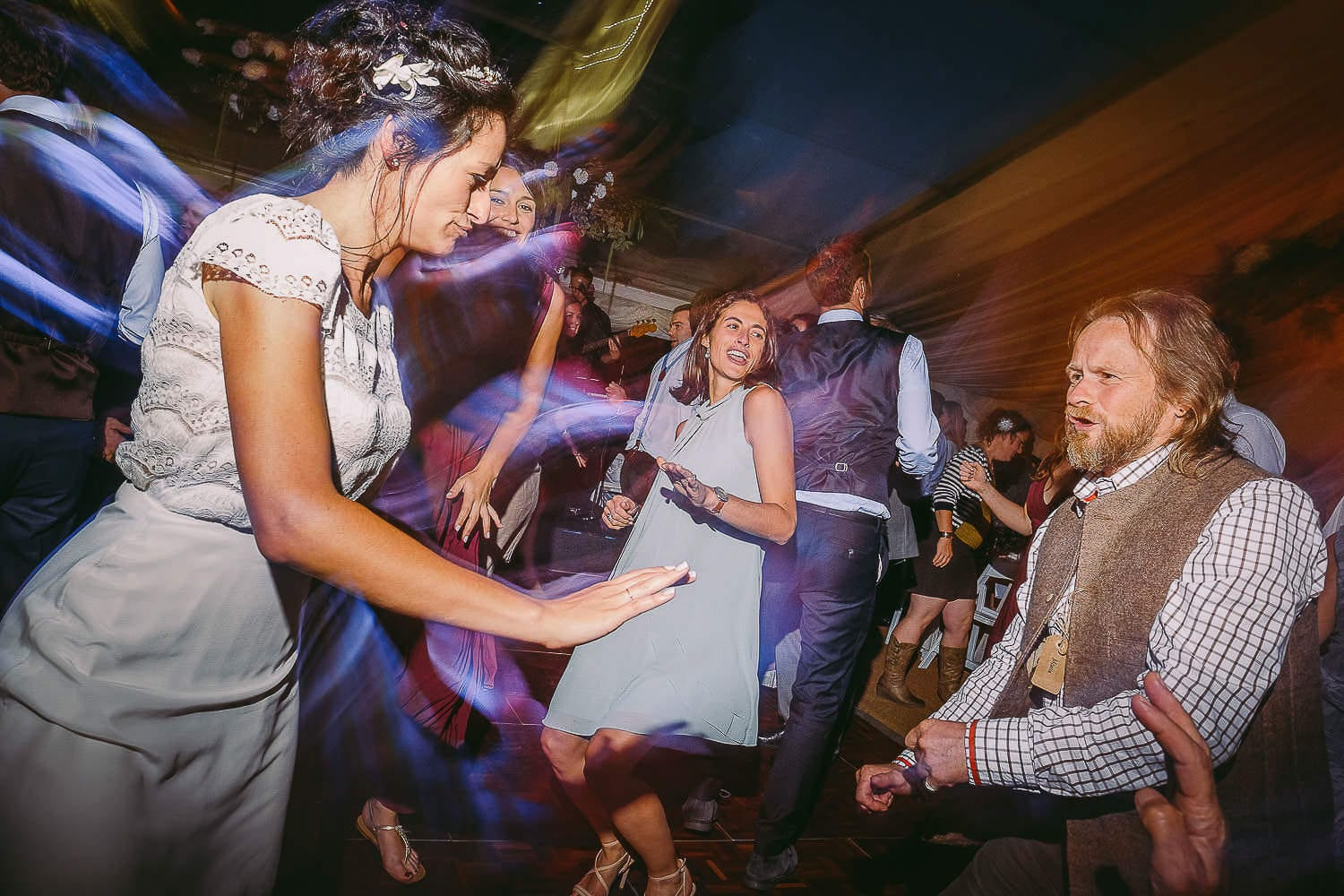 The bride and wedding guests dancing