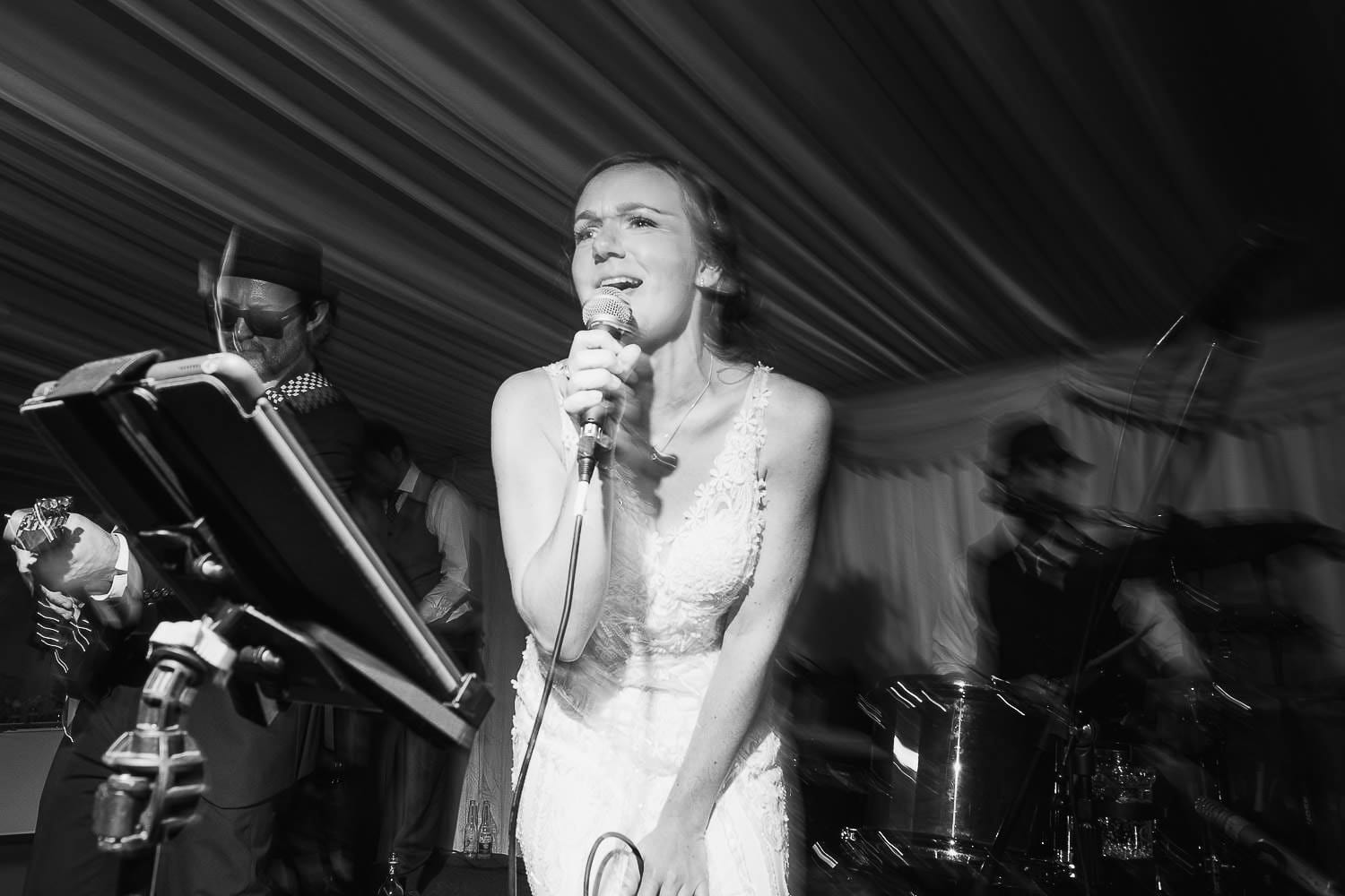 The bride sings with the band