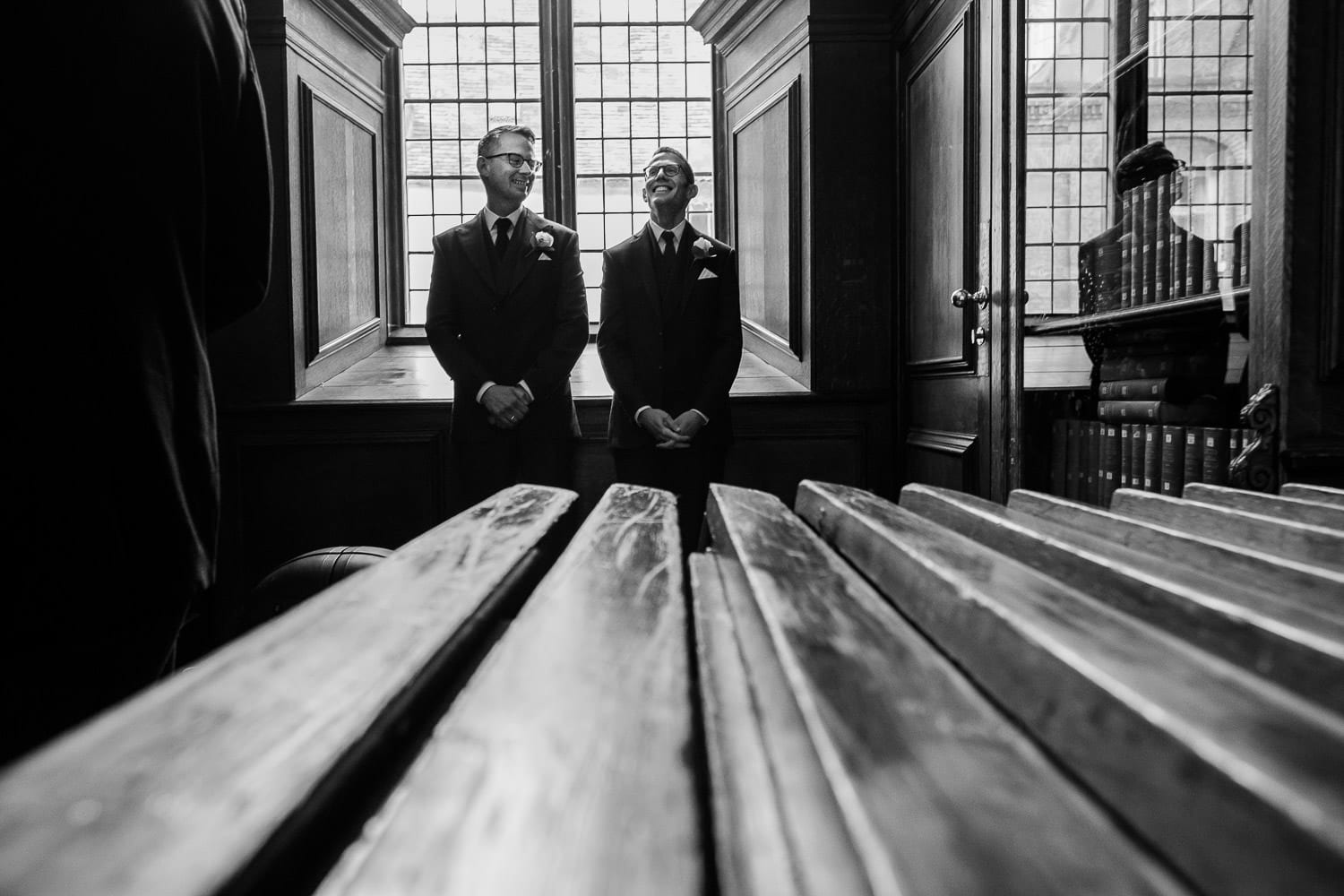 The grooms wait to be introduced
