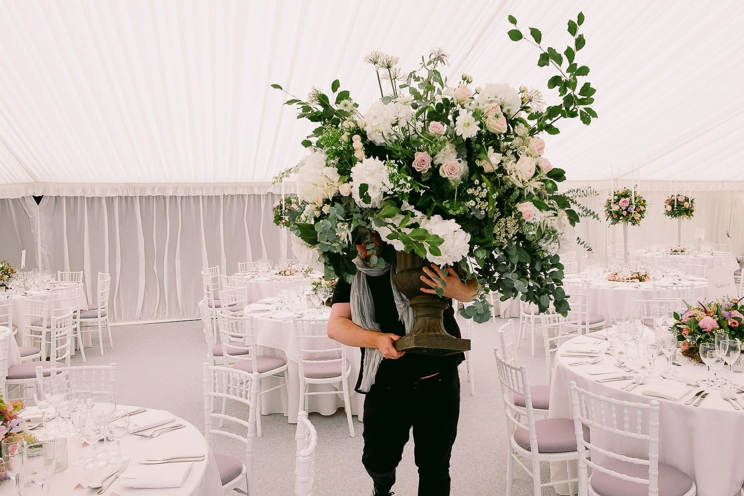 The flowers arrive into the marquee