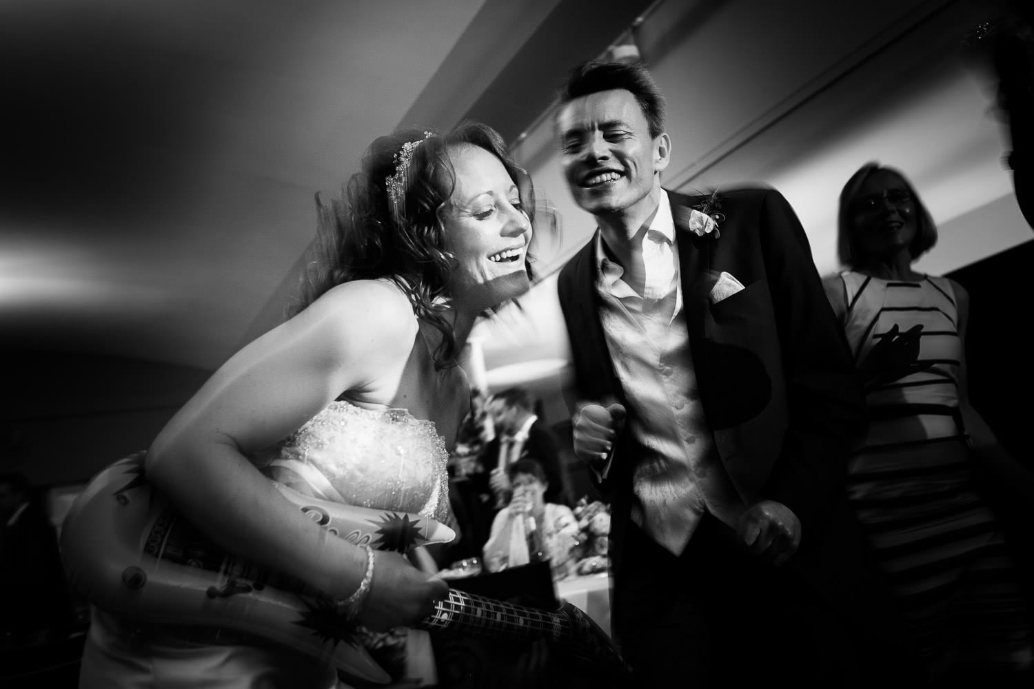 The bride plays a blow up guitar