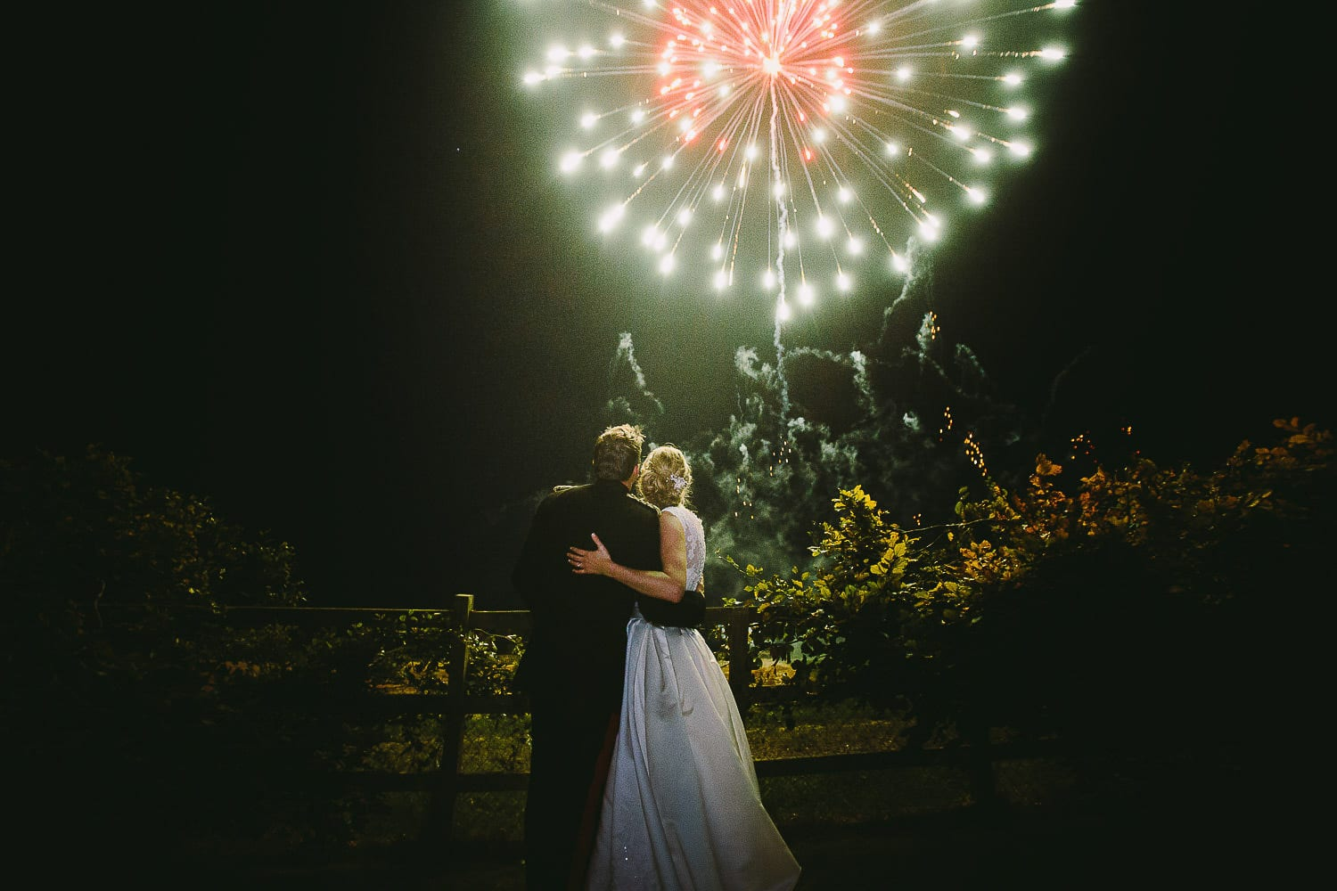 The bride and groom watch fireworks
