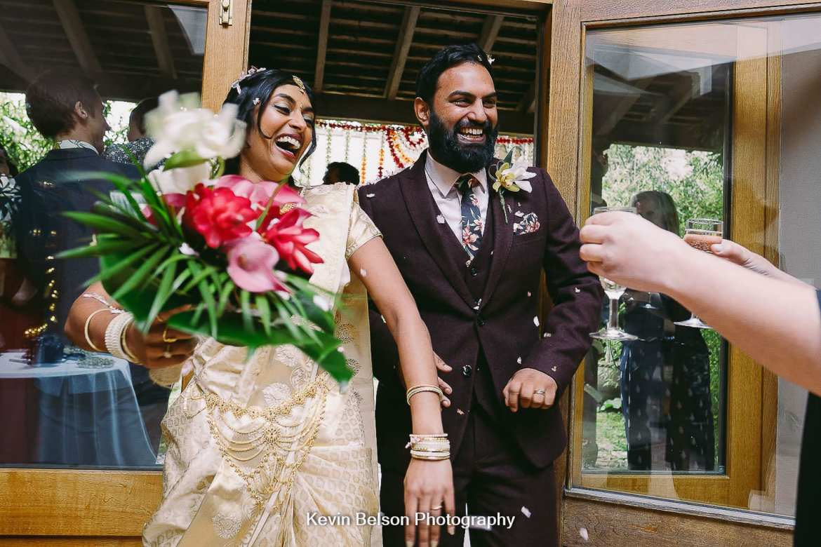 The bride and groom laughing after the ceremony at Matara
