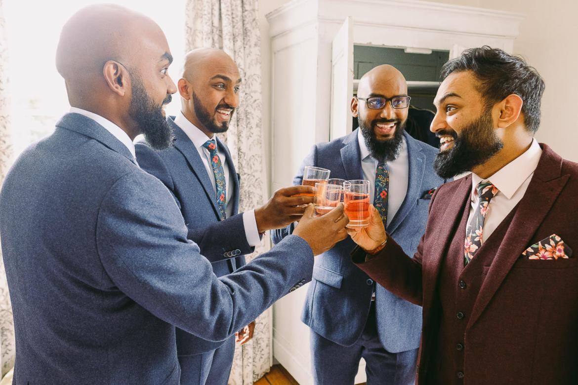 The groom and groomsmen have a drink before the ceremony