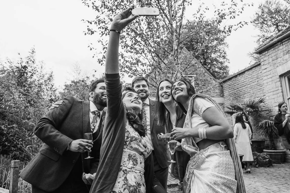 Wedding guests get a selfie with the bride and groom
