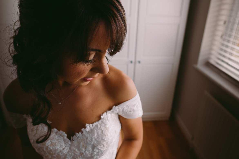 the bride checks her dress