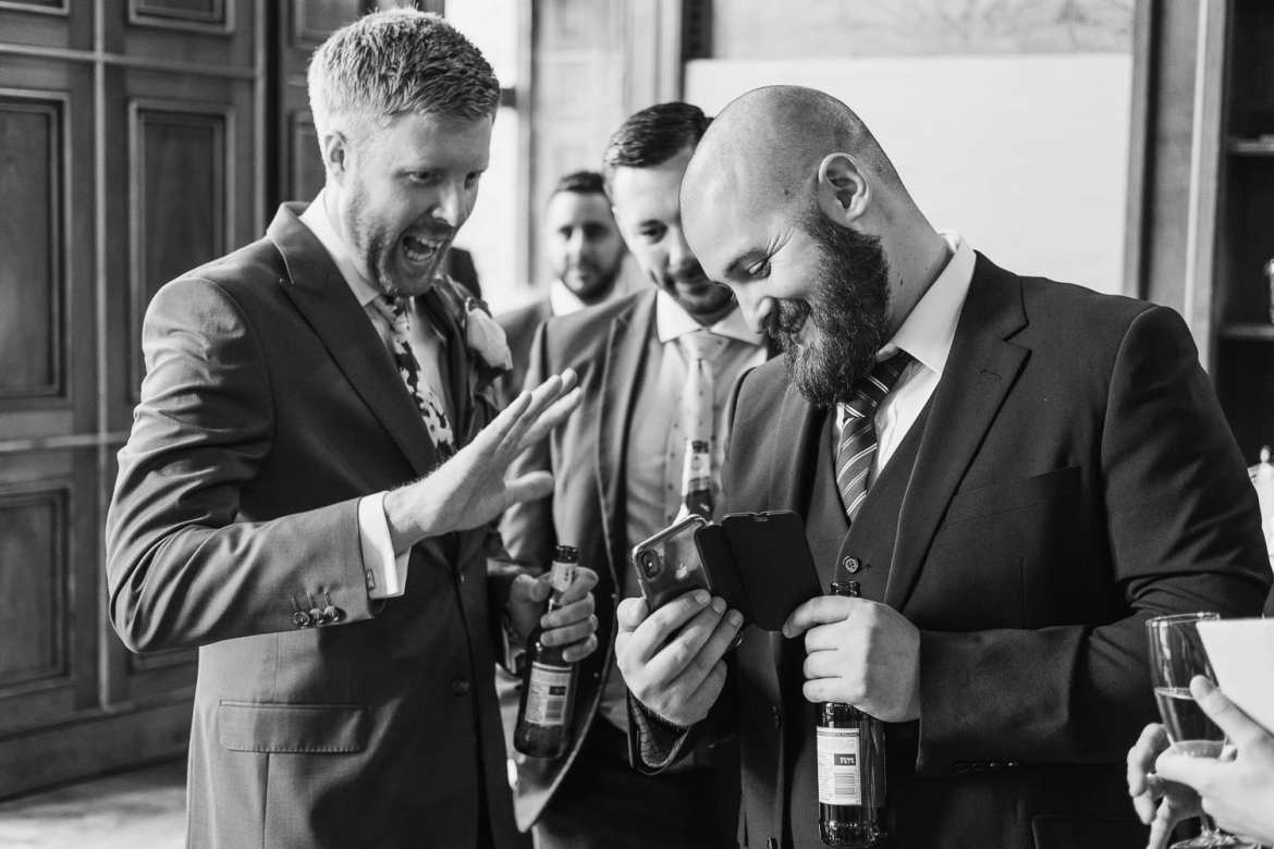 the groom and guests facetime with a friend