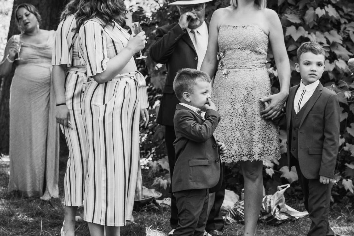 One child picks his nose during the drinks reception