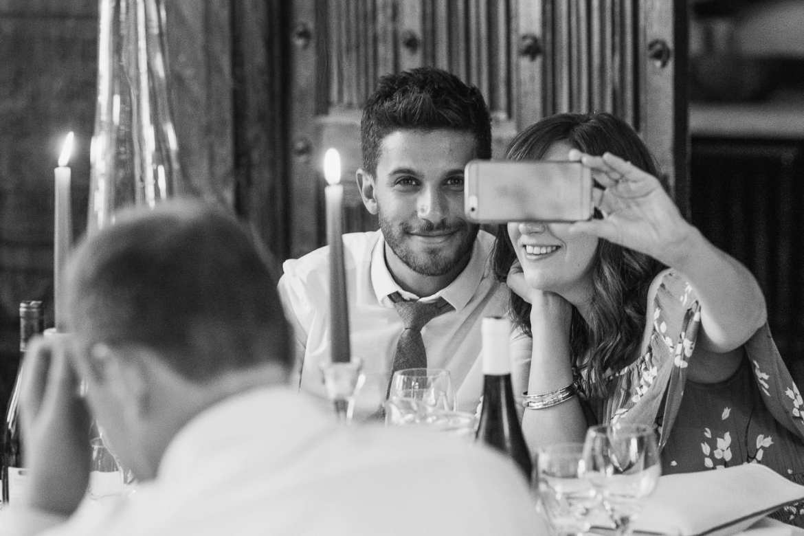 wedding guests take a selfie during the wedding breakfast