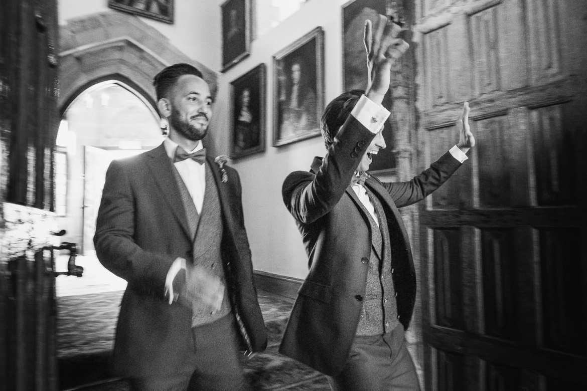 The excited grooms enter the wedding breakfast