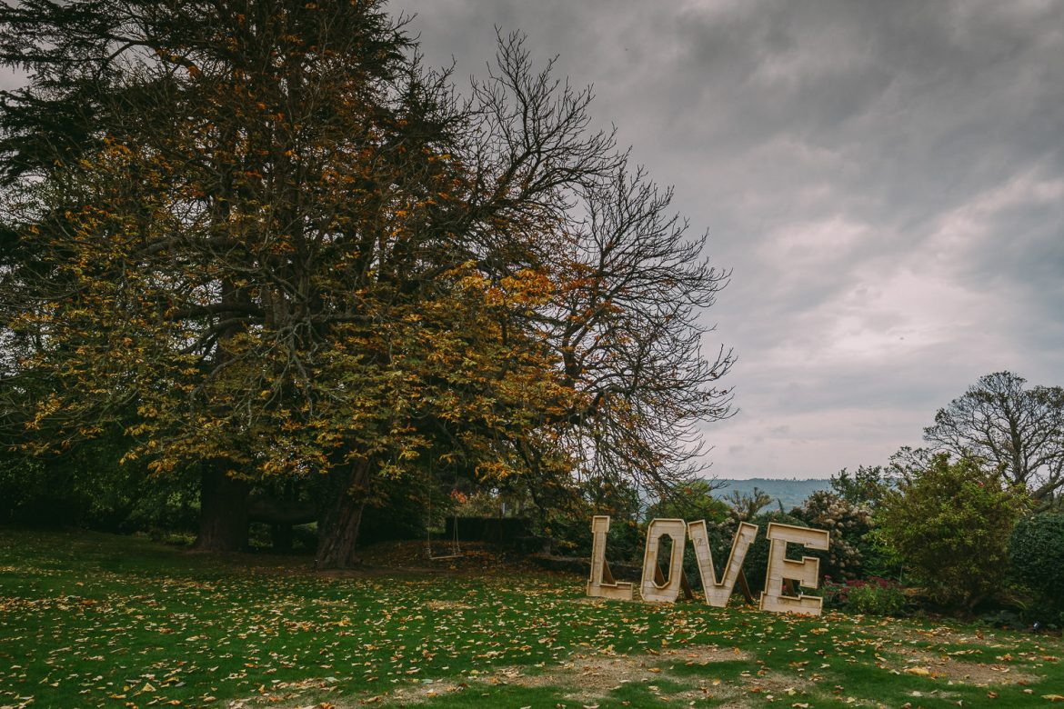 Love sign on lawn under a stormy sky