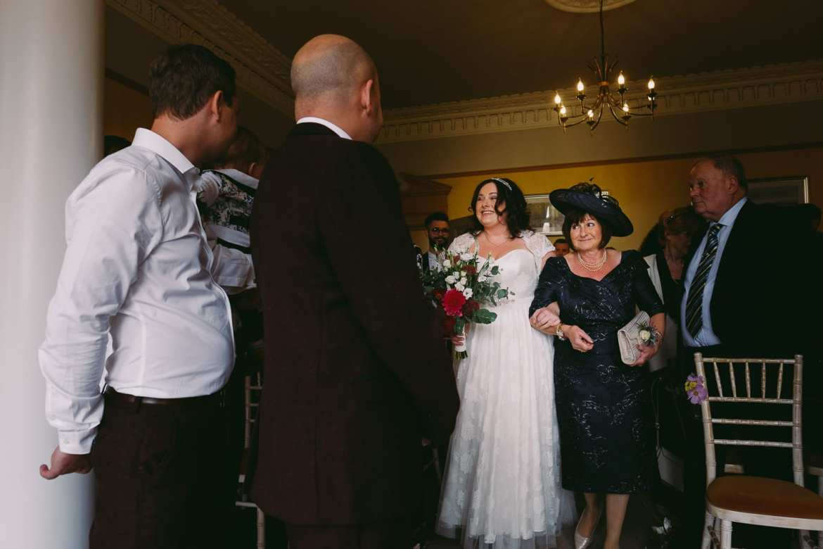 Bride walking down the aisle with her mother