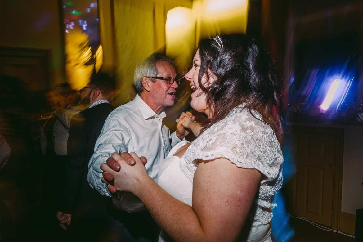 Bride dancing with her father in law