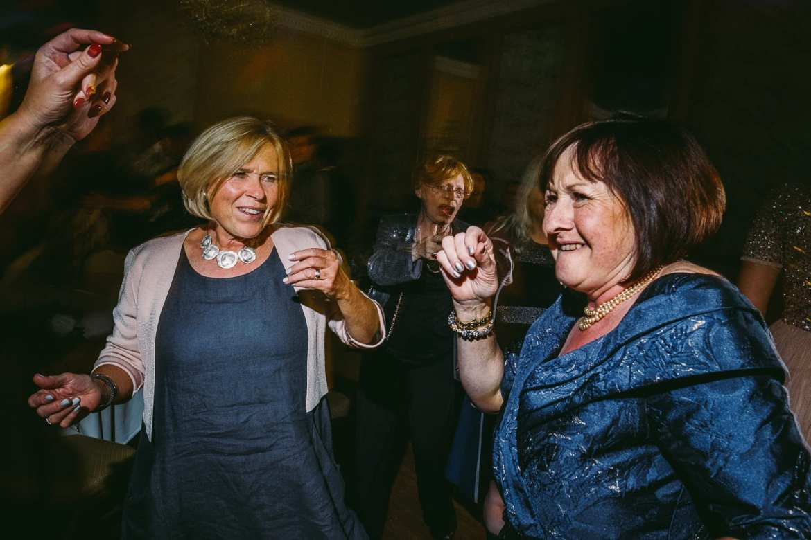 Mother of the bride having a dance with friends
