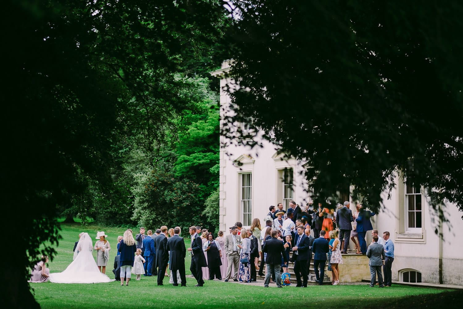 guests on the lawn outside Rockley Manor near Marlborough