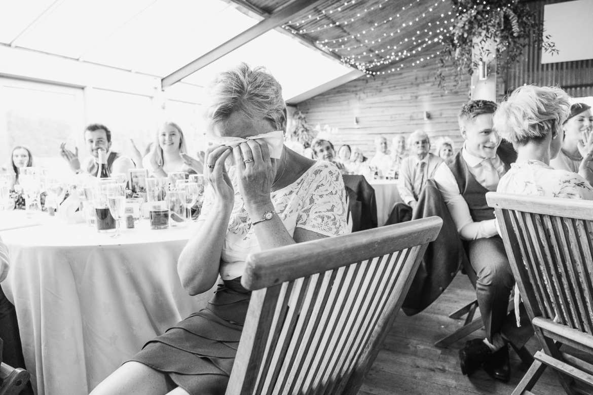 A guest cries with laughter during the speeches