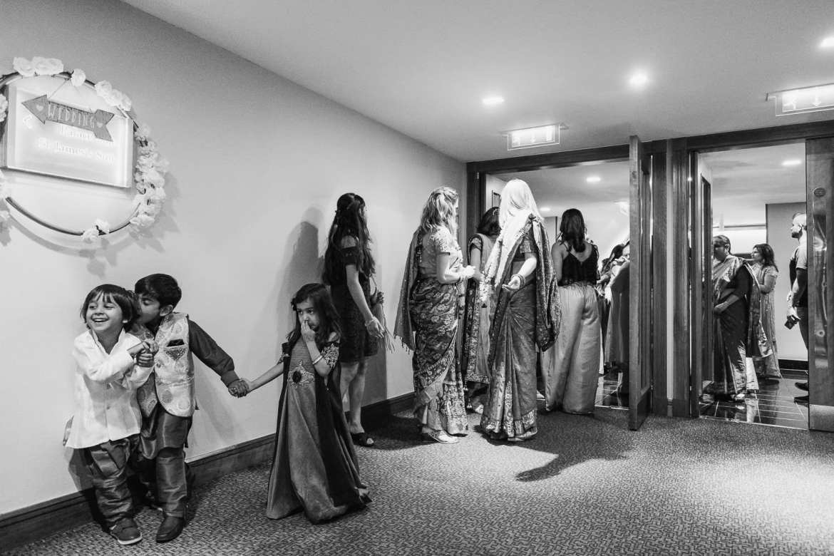 Children playing in the corridor before the wedding ceremony