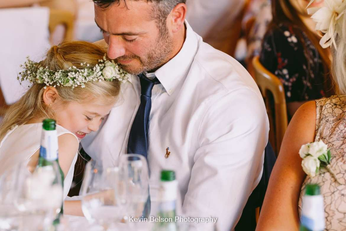 flower girl cuddles dad