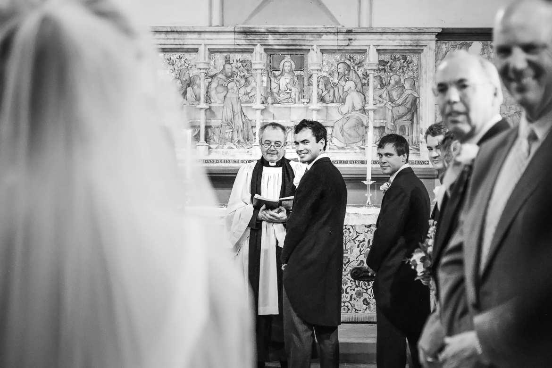 groom looks back at bride