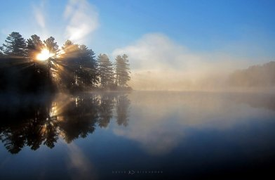 Lake of Steam: sunrise on a lake in Muskoka creates a mountain of steam rising above the water.