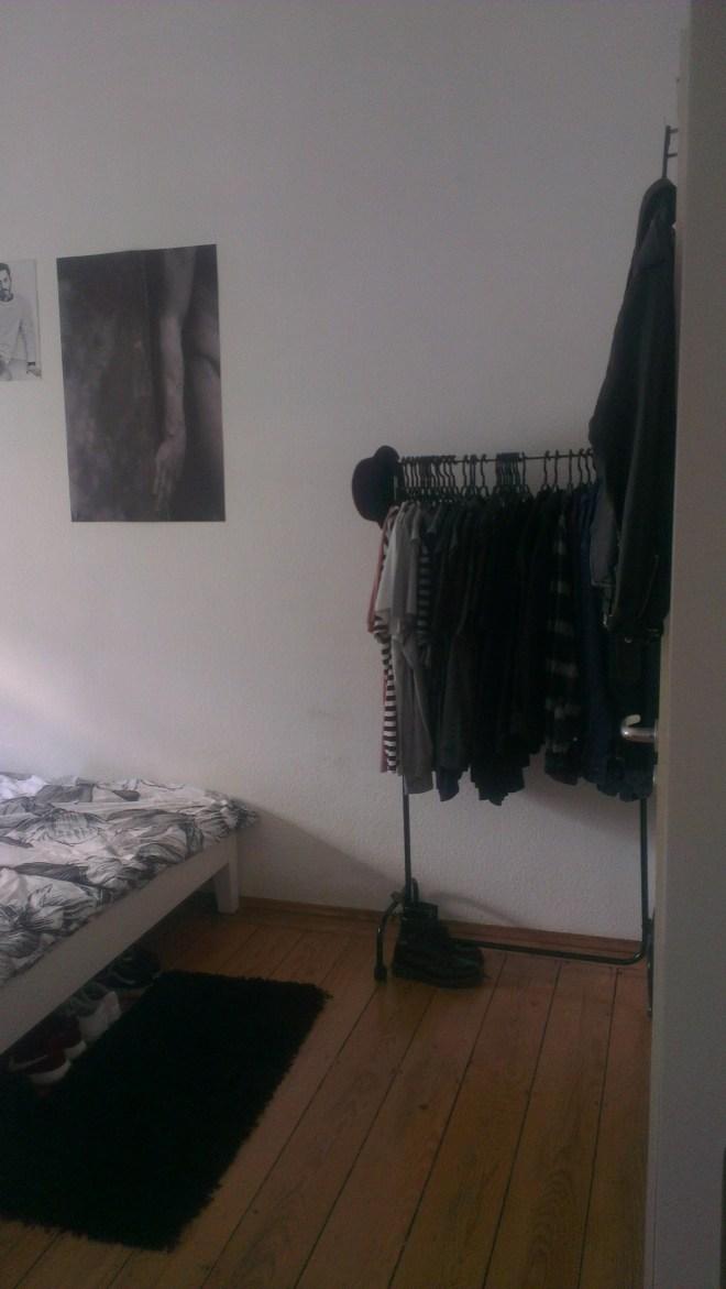 BEDROOM W/ CLOTHINGRACK