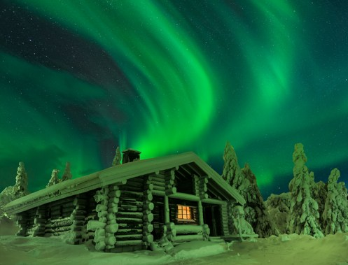 Northern Lights Over A Winter Cabin