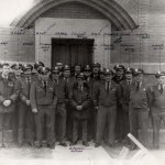 Victor Baldwin, shown fourth from right in this 1970s photo, survived being taken hostage in 1959. Many of these guards shown here were involved in the riot or began work at the prison soon afterwards.