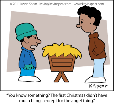 "Cartoon of two boys staring at a manger. On says, ""You know something? The first Christmas didn't have much bling... except for the angel thing."""