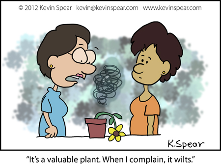 "Cartoon of two women next to a wilted plant. One woman says, ""It's a valuable plant. When I complain, it wilts."""