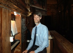 Kevin at the first organ he ever played outside the U.S. at Chiesa Santa Maria in Valvendra, Lovere, Italy.